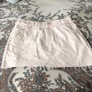 Frayed bottom pale pink jean skirt